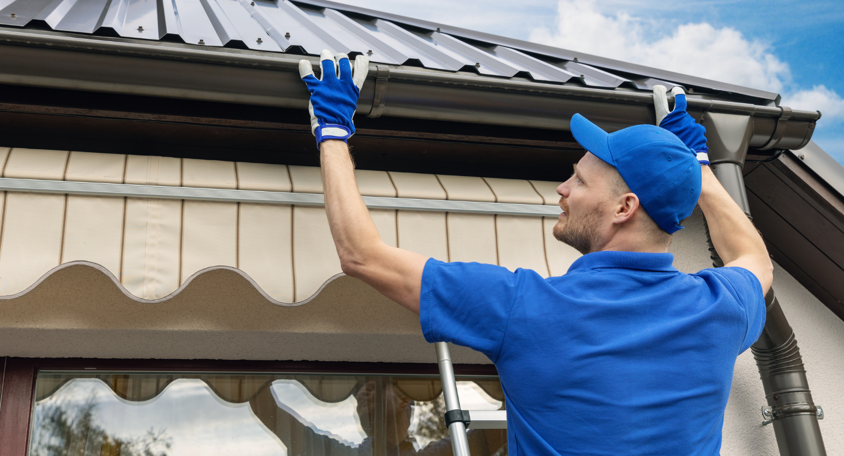 Image of a man installing gutters