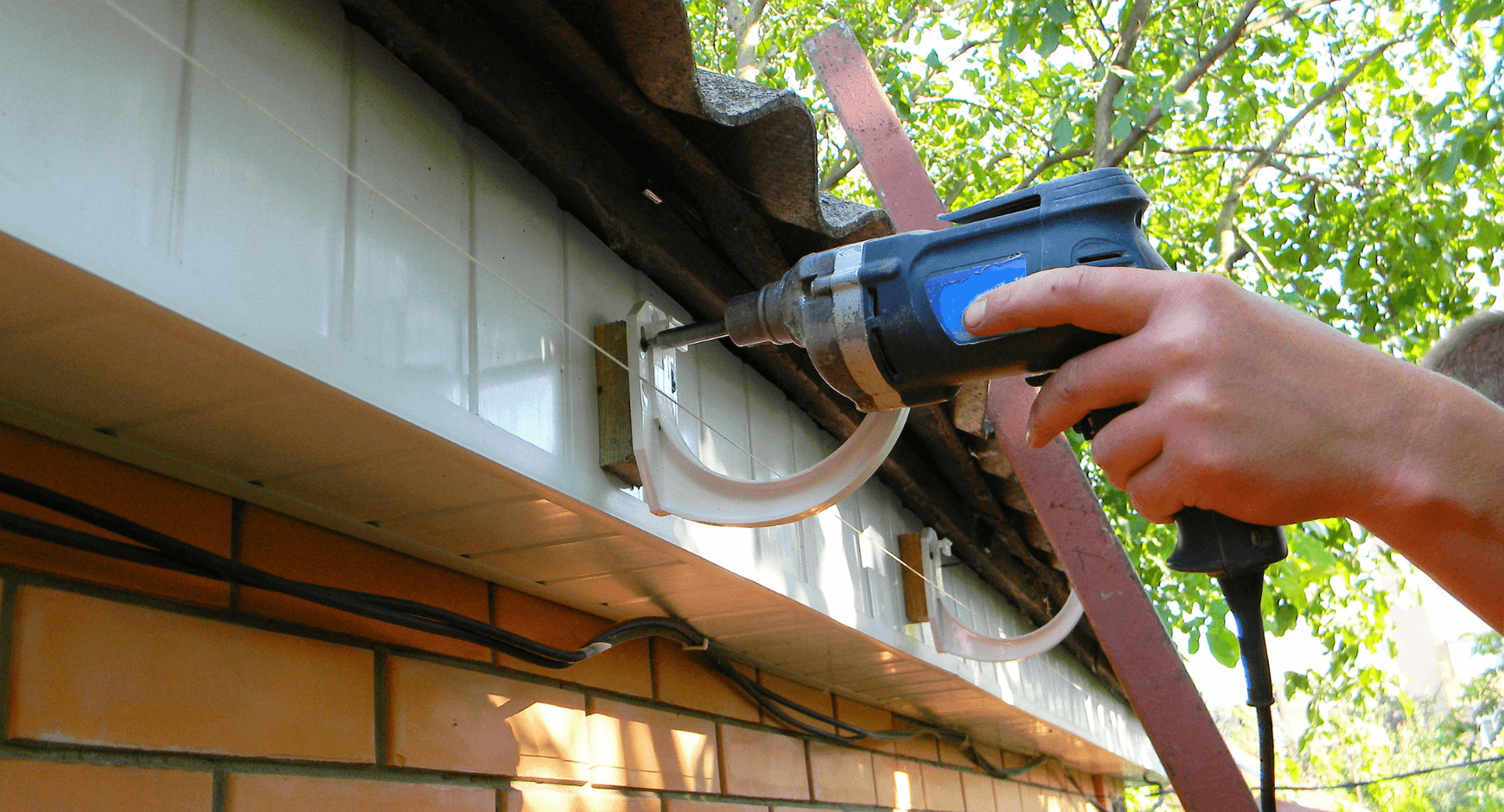 Image of an individual hanging gutters
