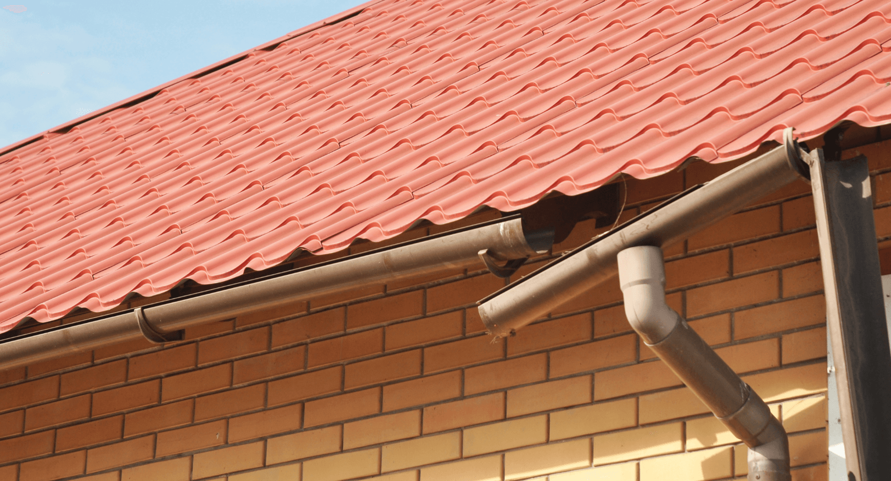 Image of gutters that sagged so badly they broke