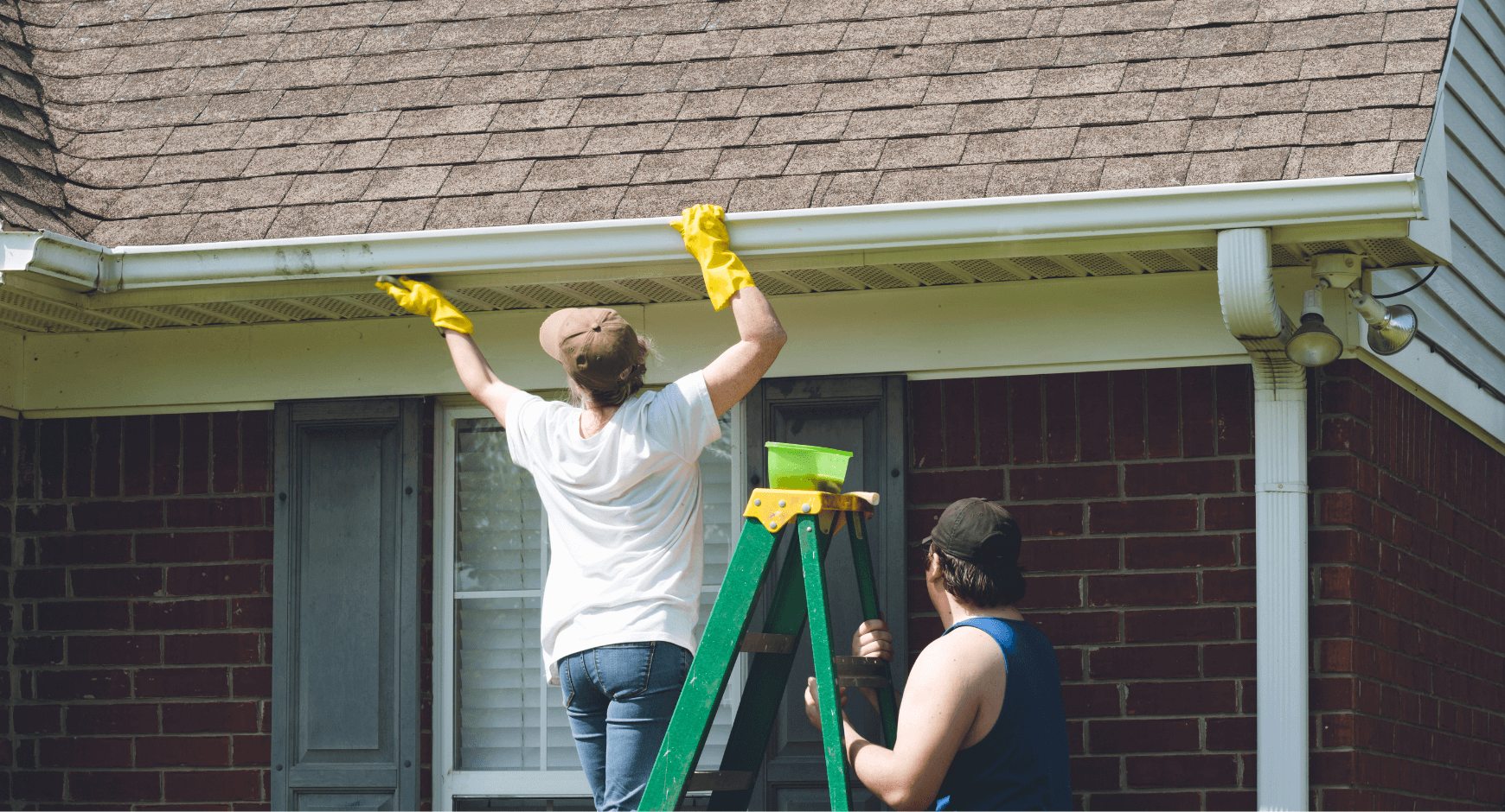image of a woman repairing gutters