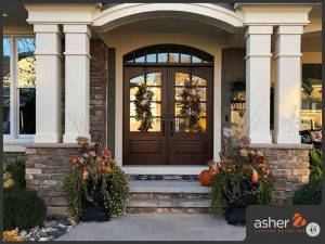 Speciality window replacement in front of home by Asher Exteriors.