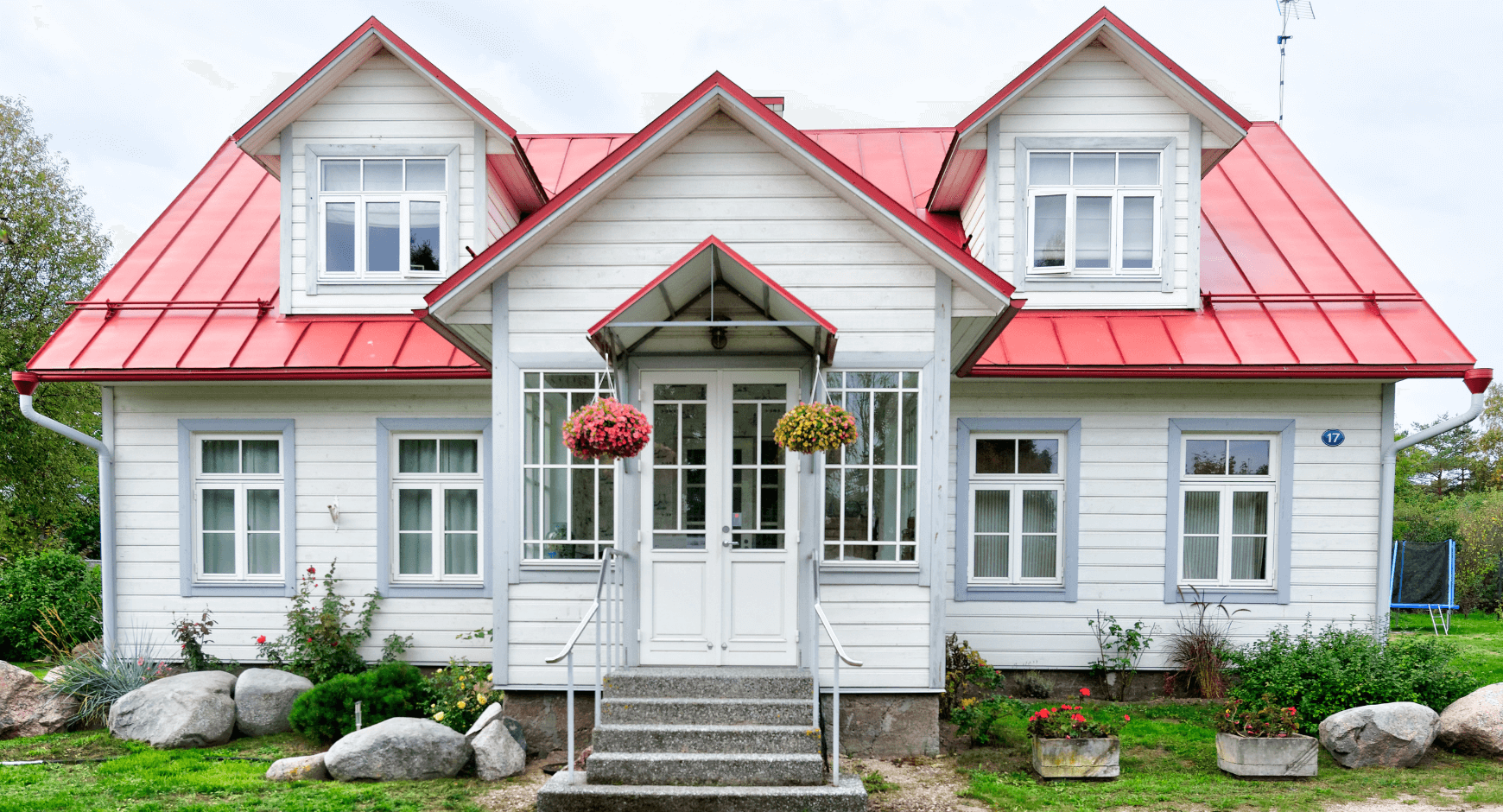Image of a beautiful home with wood exterior window trim