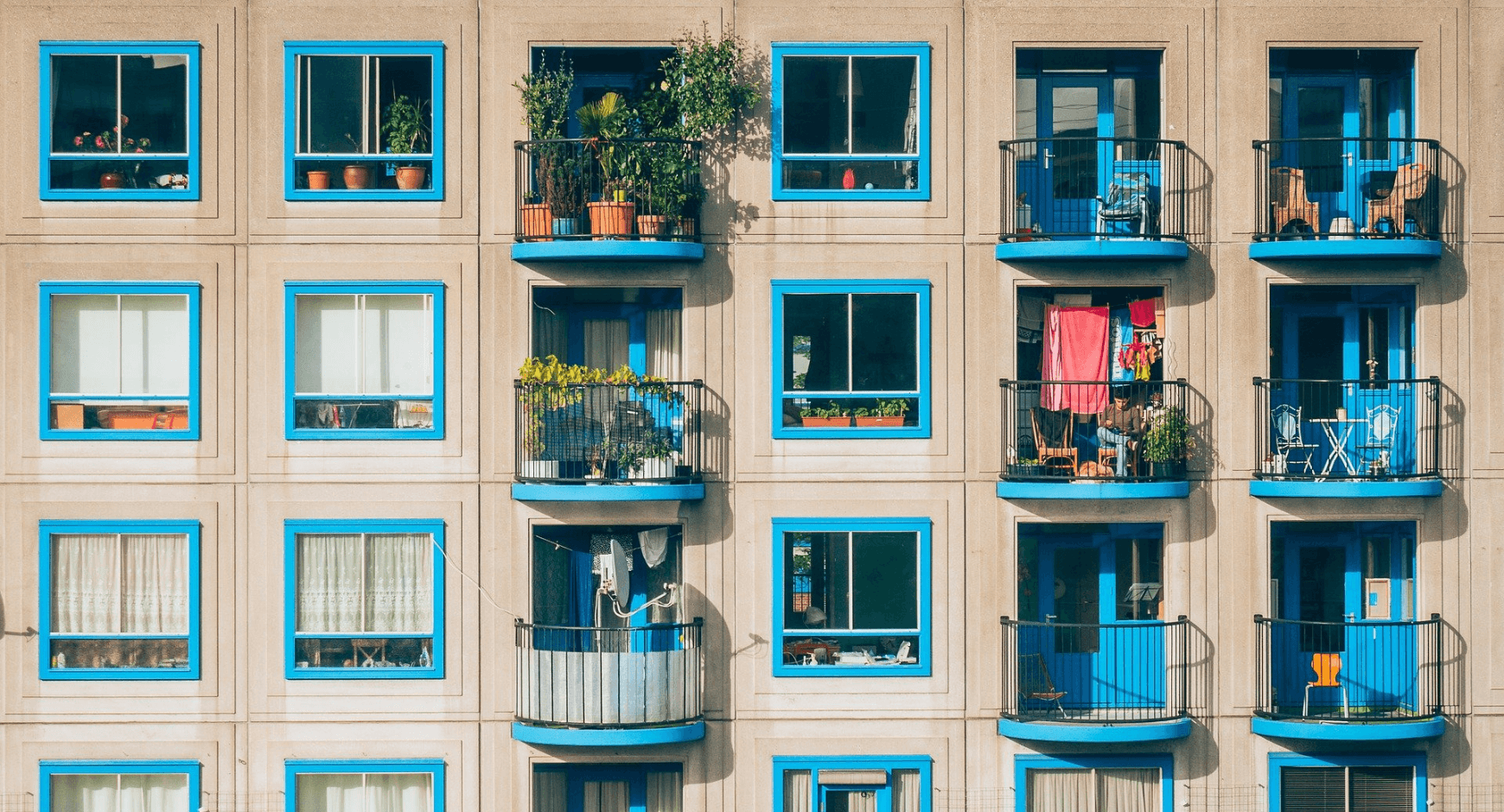 Image of an apartment building with fun, colorful exterior window trim