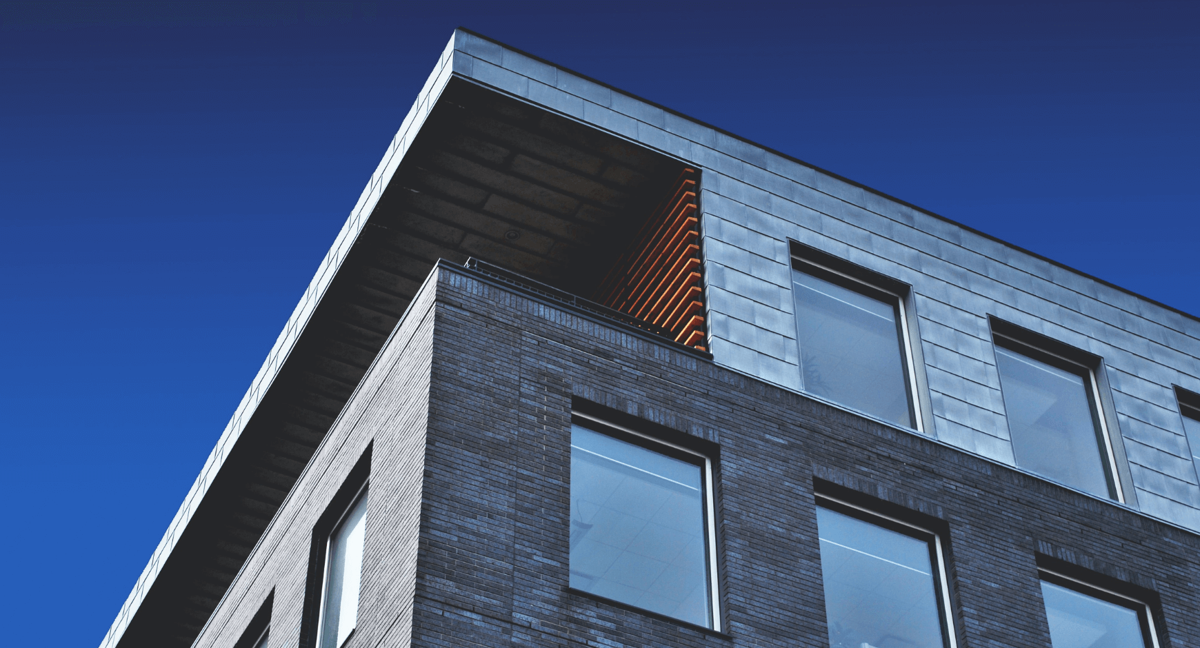 Image of a building with simple window trim