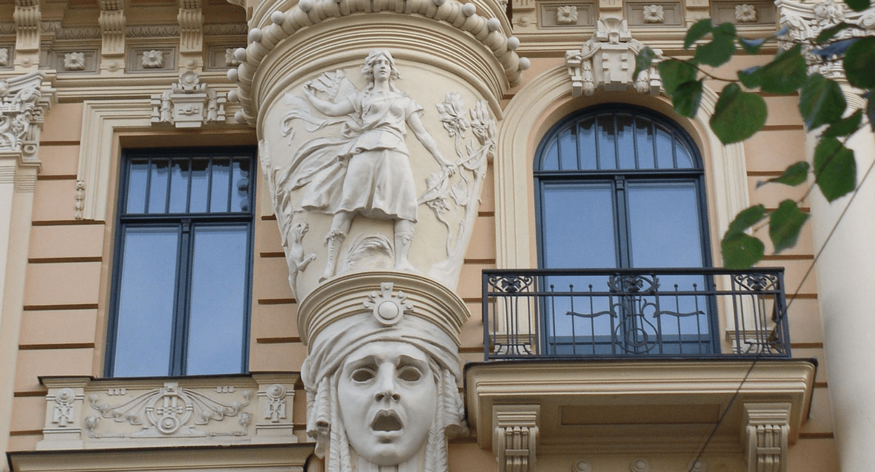 Image of an older building with stucco style window trim
