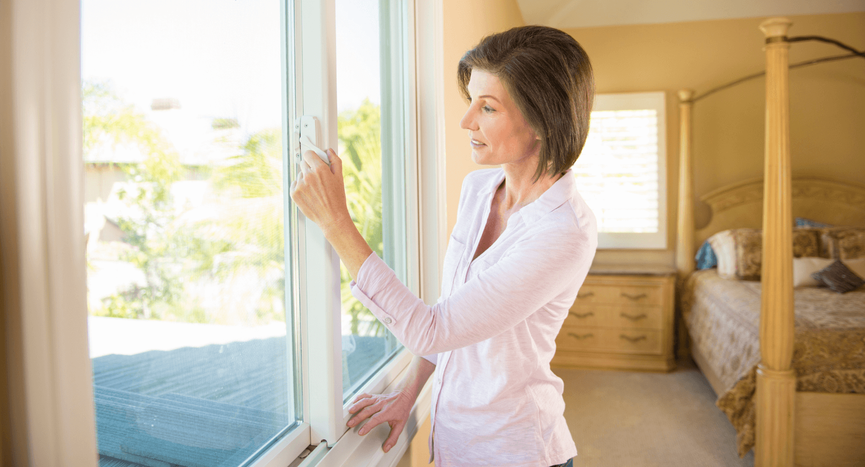 Image of a woman opening a gliding window
