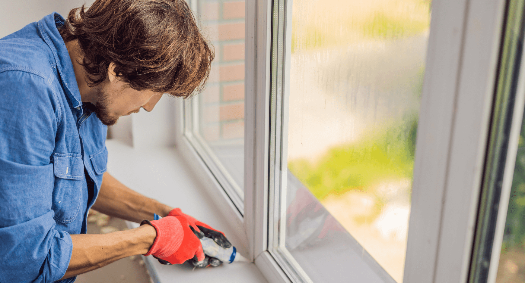 Image of a man installing a new window