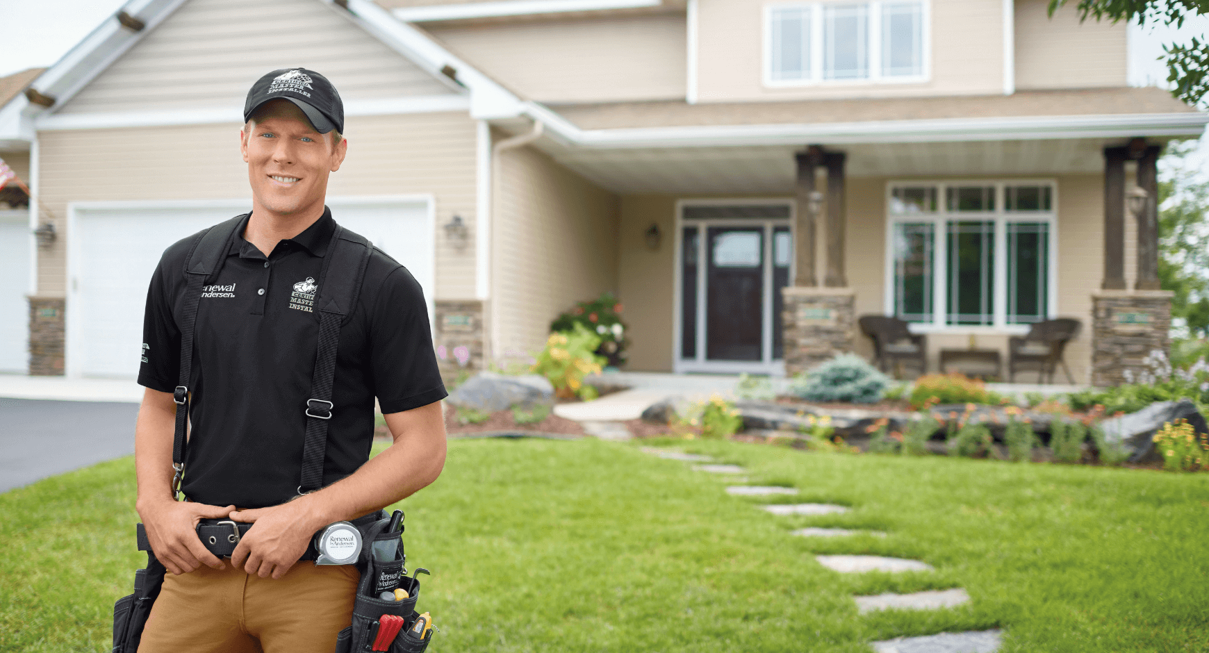 Image of a man standing in front of a home